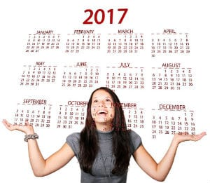 Woman looking at the calendar of 2017 to schedule her K-1 Fiance Visa Embassy Phase interview.