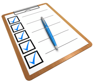 Clip board and paper with checkmarks on forms needed