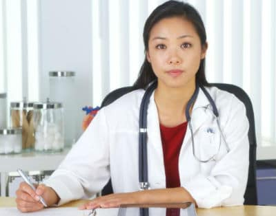 A female Filipino doctor is part of the SLEC medical exam experience.